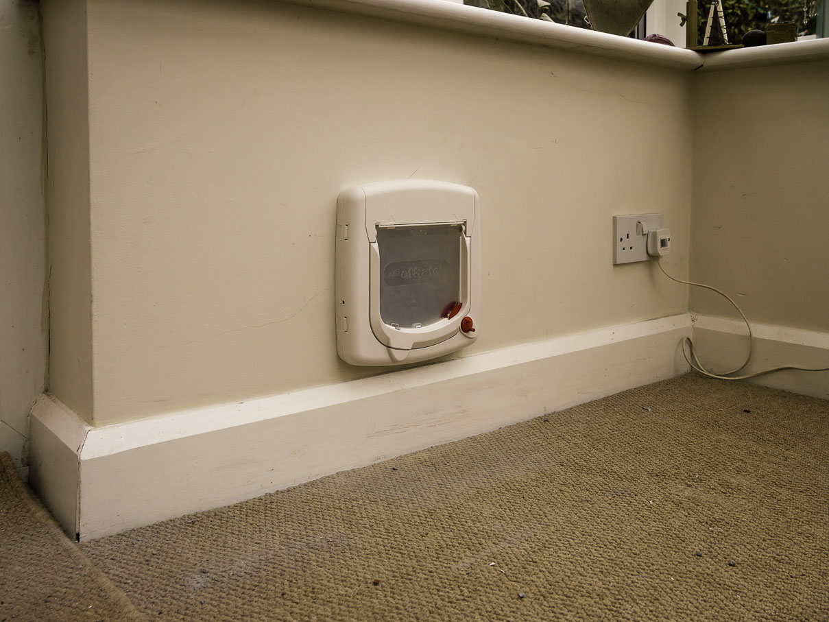 Cat Flap Installation in Wall, brick, rendered and Breeze block